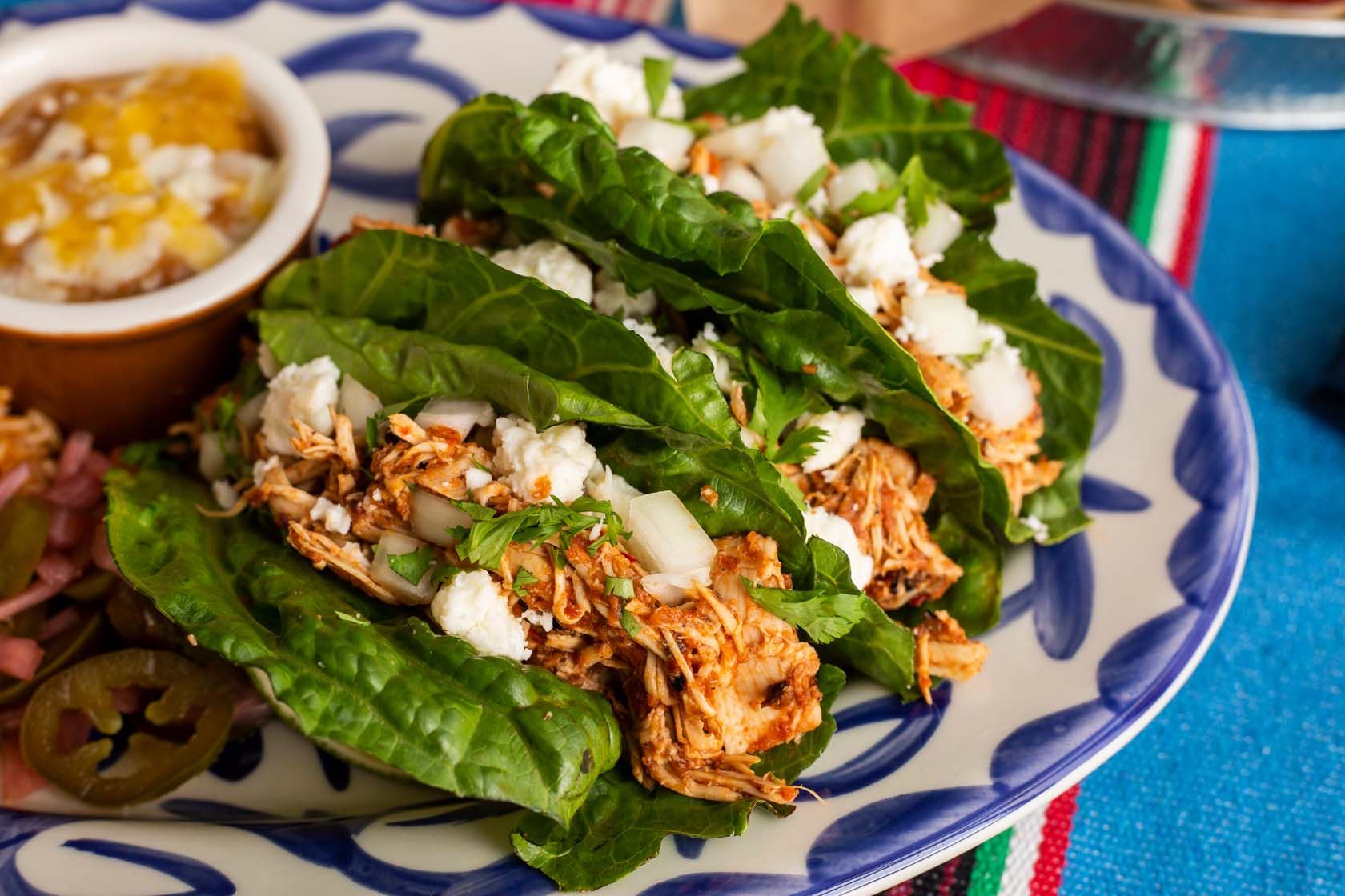Three gluten-free friendly tacos served with lettuce wraps as tortillas and chicken Tinga filling.