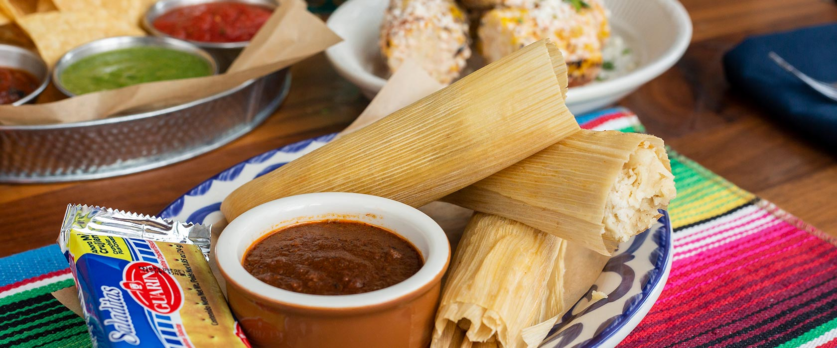Plated hot tamales on colorful table